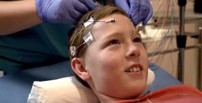 A boy being prepared for an EEG.