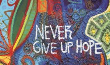 "Mural with the words ""Never give up home"""