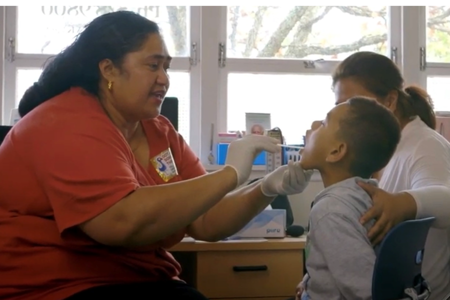 Boy having sore throat checked at a clinic