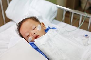 Baby boy having oxygen in hospital