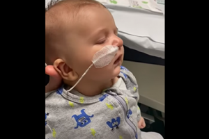 Baby with oxygen tube having trouble breathing