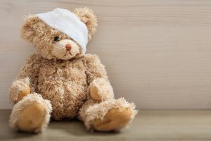 Teddy bear with a bandage on its head